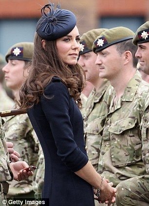 Kate in command: Duchess of Cambridge does dress uniform as she carries out first military role as a royal