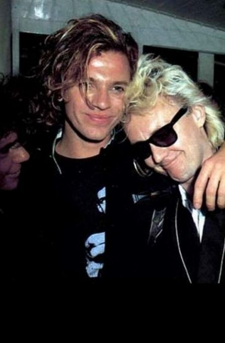 Michael Hutchence Roger Taylor with