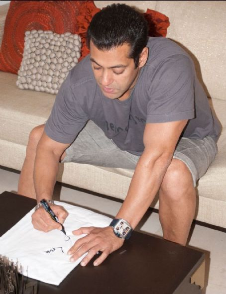Salman Khan signing 'Being Human' T-shirts Pics - From Twitter @BeingSalmanKhan