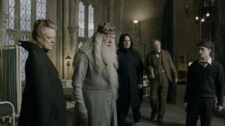 Severus Snape (L-r) MAGGIE SMITH as Professor Minerva McGonagall, MICHAEL GAMBON as Professor Albus Dumbledore, ALAN RICKMAN as Professor , JIM BROADBENT as Professor Horace Slughorn and DANIEL RADCLIFFE as Harry Potter in Warner Bros. Pictures' fantas