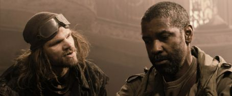 Evan Jones (L-r) EVAN JONES as Martz and DENZEL WASHINGTON as Eli in Alcon Entertainment's action adventure film 'The Book of Eli,' a Warner Bros. Pictures release. Photo courtesy of Warner Bros. Pictures. TM & © 2009 Warner Bros. Entertainment Inc. All