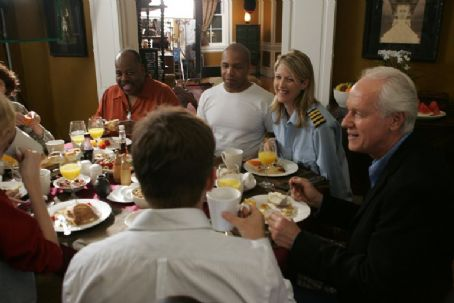 Reginald VelJohnson , Mystro Clark, Andrea Marcellus and Mike Farrell in the scene of comedy romance 'Out at the Wedding.'