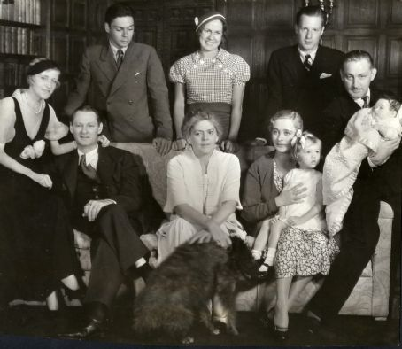 Irene Fenwick and Lionel Barrymore (both seated to the left)