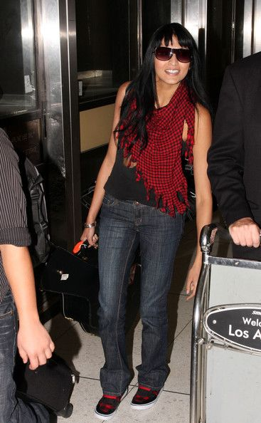 Tinsel Korey Arrives at LAX With Her Guitar