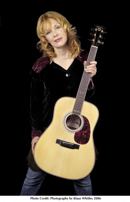 Heart Nancy Wilson of  holding the guitar she designed