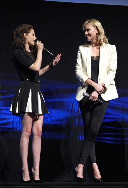 Kristen Stewart backstage at CinemaCon 2012 with Charlize Theron