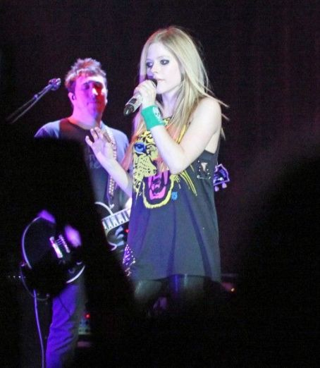 Avril Lavigne is pictured performing live on stage in Vancouver during her Black Star tour