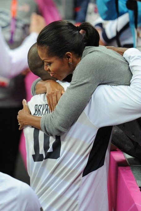 First Lady Michelle Obama cheering on the USA Men's Basketball as they defeated France in London (July 29)