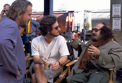 Screwed Directors/Screenwriters Larry Karaszewski and Scott Alexander with Danny DeVito on the set of Universal's comedy  - 2000