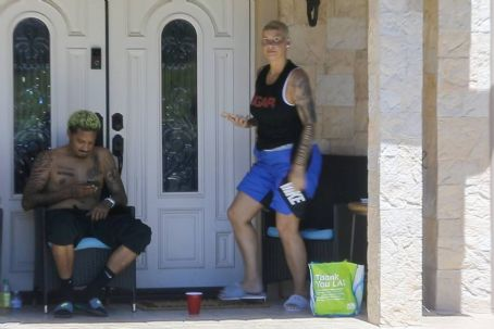 Amber Rose and Alexander Edwards – Seen in front of her home