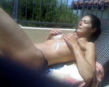 Adrianne Curry's Topless Sunbathing Session