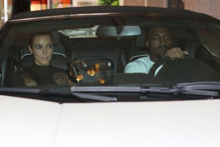 Kim Kardashian and her rapper boyfriend Kanye West kept their white Lamborghini for an extra day to take a driving tour of Paris, France on June 18, 2012