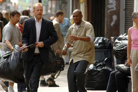 "Mos Def Bruce Willis as Jack Mosley and  as Eddie Bunker star in Alcon Entertainment and Millennium Films' action thriller ""16 Blocks,"" also starring David Morse and distributed by Warner Bros. Pictures. Photo by Barry Wetcher."