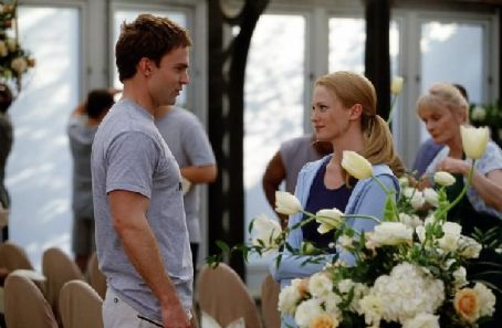 Seann William Scott Stifler () attempts to romance maid-of-honor Cadence (January Jones)