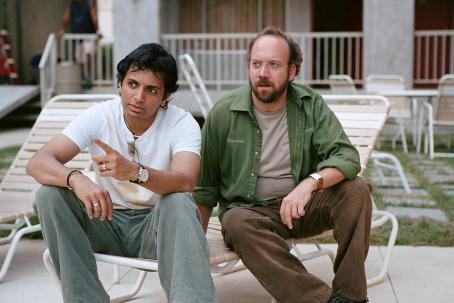 "M. Night Shyamalan Director  and Paul Giamatti on the set of Warner Bros. Pictures' and Legendary Pictures' ""Lady In The Water,"" distributed by Warner Bros. Pictures. Photo by Frank Masi"