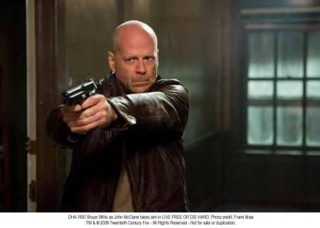Live Free or Die Hard Bruce Willis as John McClane takes aim in LIVE FREE OR DIE HARD. Photo credit: Frank Masi