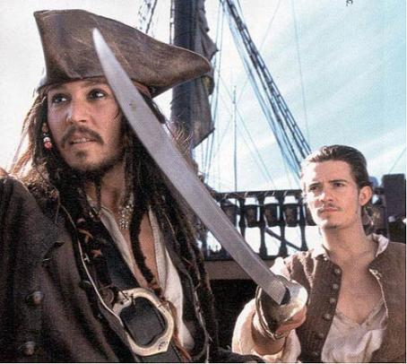 Jack Sparrow Johnny Depp and Orlando Bloom of Walt Disney's Pirates Of The Caribbean: The Curse of the Black Pearl - 2003