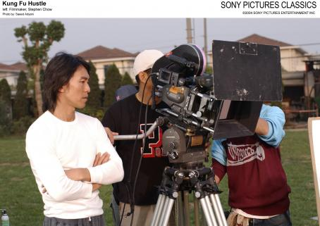 Stephen Chow Left: Filmmaker, .