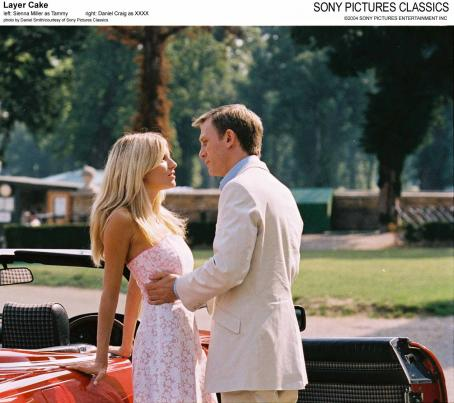 XXXX Left: Sienna Miller as Tammy; Right: Daniel Craig as .