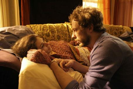 Kris Holden-Ried Lia (Lisa Ray) and Jack (Kristen Holden-Ried) at couch.