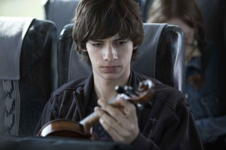 "Adoration ""Simon (Devon Bostick) examines his mother's violin on the bus."" Photo: Sophie Giraud. ©  Productions. Courtesy of Sony Pictures Classics. All Rights Reserved."