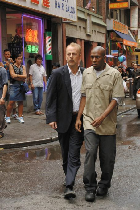 "Mos Def Bruce Willis as Jack Mosley and   as Eddie Bunker star in Alcon Entertainment and Millennium Films' action thriller ""16 Blocks,"" also starring David Morse and distributed by Warner Bros. Pictures. Photo by Barry Wetcher"