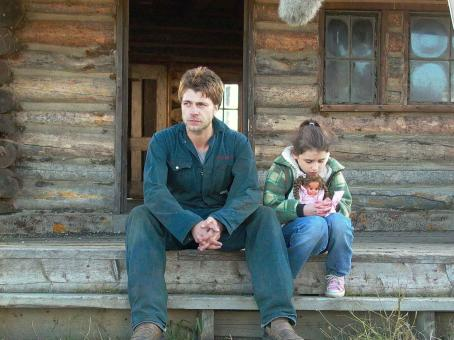 Jamie Draven Jerry () and his daughter Celina (Grace Fulton) on farmhouse steps. Photo Credit: © 2007 Badland Corporation