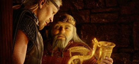 "Ray Winstone As a reward for his heroism, the Viking hero, Beowulf (left), is offered a precious reward by the grateful King Hrothgar (right) in ""Beowulf."" Courtesy of Paramount Pictures. © 2007 by Paramount Pictures and Shangri-la Entertainment, LLC. All"