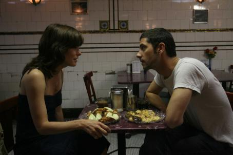 Melvil Poupaud Parker Posey and  in BROKEN ENGLISH, a Magnolia Pictures release. Photo courtesy of Magnolia Pictures.
