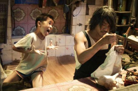 Stephen Chow Left: Xu Jiao as Dicky Chow; Right:  as Ti Chow. © 2007 Star Overseas Group, Courtesy Sony Pictures Classics. All Rights Reserved.