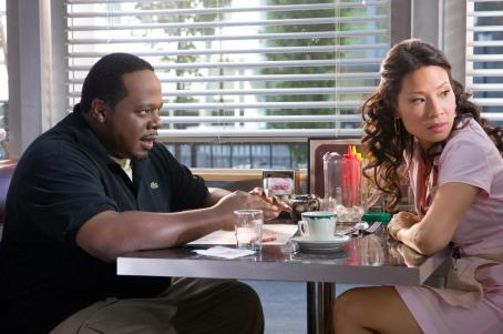 "Cedric the Entertainer  as ""Jake"" and Lucy Liu as ""Gina"" in New Line Cinema's action comedy Code Name: The Cleaner. Photo Credit: 2005 Annabel Reyes/New Line Productions"