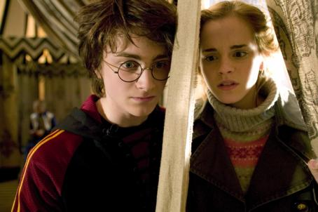 "Hermione Granger (L-r) Daniel Radcliffe as Harry Potter and Emma Watson as  in Warner Bros. Pictures' fantasy ""Harry Potter and the Goblet of Fire."" Photo by Murray Close"