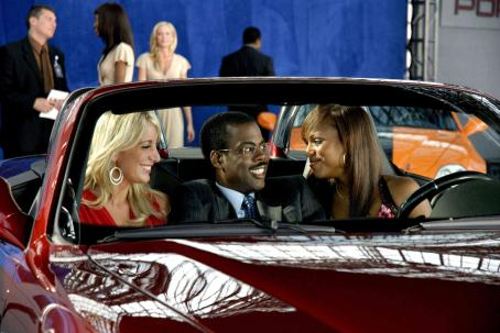 I Think I Love My Wife Car show model and Chris Rock with Kerry Washington in I THINK I LOVE MY WIFE. Photo Credit: Phil Caruso