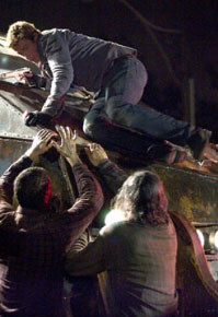 Simon Baker Riley (SIMON BAKER, above center) attempts to outmaneuver a growing and evolving horde of the dead in George Romero's Land of the Dead.
