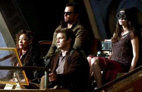 Nathan Fillion Zoe (Gina Torres), Jayne (Adam Baldwin), Captain Mal Reynolds () and River Tam (Summer Glau).