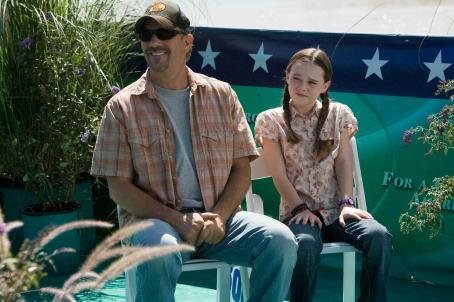 Swing Vote Kevin Costner as Bud Johnson and Madeline Carroll as Molly Johnson in Walt Disney Studios Motion Pictures comedy drama '.'