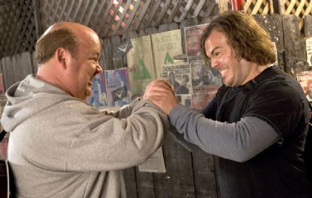 Kyle Gass Jack Black as JB and  as KG in action with cafe setting.