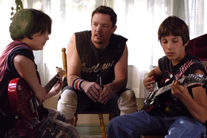 Matthew Lillard  teaches his kids how to rock out in Bauer Martinez's THE GROOMSMEN, written and directed by Edward Burns.