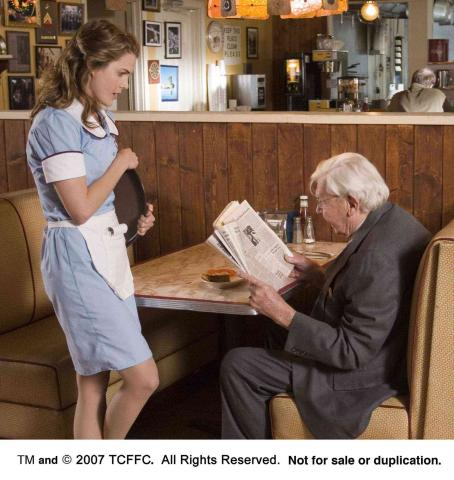 Andy Griffith  (old Joe) tells Keri Russell her horoscope for the day. Photo Credit: Alan Markfield