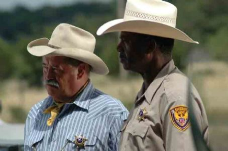 Charles Durning Barry Corbin as Sheriff Buster Watkins and  as Murray Blythe in River's End