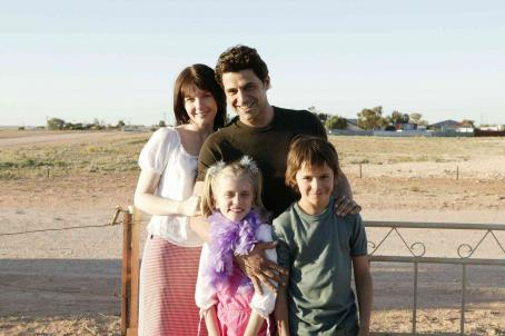 Jacqueline McKenzie Kellyanne Williamson (Sapphire Boyce) foreground left, Ashmol Williamson (Christian Byers) foreground right hugging their parents Rex Williamson (Vince Colosimo) background right and Annie Williamson () background left.