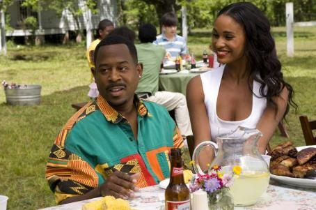 Welcome Home, Roscoe Jenkins RJ (MARTIN LAWRENCE) and reality-TV-star fiancée Bianca (JOY BRYANT) try and charm his family in a comedy about a self-help guru who is returning to the very place he tried to forget—Welcome Home Roscoe Jenkins. Credit: David Lee