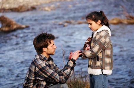 Jamie Draven Jerry () looks at his daughter Celina's (Grace Fulton) injured hand. Photo Credit: © 2007 Badland Corporation.