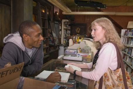 "Mos Def  (left) stars as ""Mike"" and Mia Farrow (right) stars as ""Ms. Kimberley"" in New Line Cinema's upcoming release of Michel Gondry's BE KIND REWIND. Photo Credit: Abbot Genser/New Line Cinema"