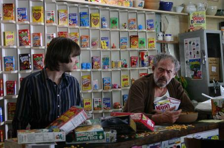 Aaron Stanford  as Neal Downs and Christopher Lloyd as Willie in FLAKES directed by Michael Lehmann. Photo credit: Jake Abraham. An IFC First Take release.