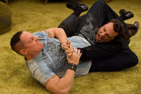 Jon Favreau (L-r) Denver (JON FAVREAU) inflicts a new martial arts move on his brother Brad (VINCE VAUGHN) in New Line Cinema's romantic comedy, 'Four Christmases,' also starring REESE WITHERSPOON. The film is distributed by Warner Bros. Pictures. Photo: