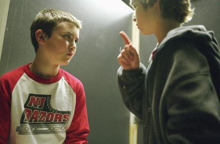 Cameron Bright (Left to Right)  as Oleg Yugorsky with Alex Neuberger as Nicky Gazelle in New Line Cinema's fast-paced crime drama, RUNNING SCARED