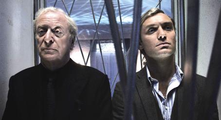 Sleuth Left: Michael Caine as Andrew Wyke. Right: Jude Law as Milo Tindle. Photo by David Appleby © 2007  Productions LTD, courtesy Sony Pictures Classics. All Right Reserved.