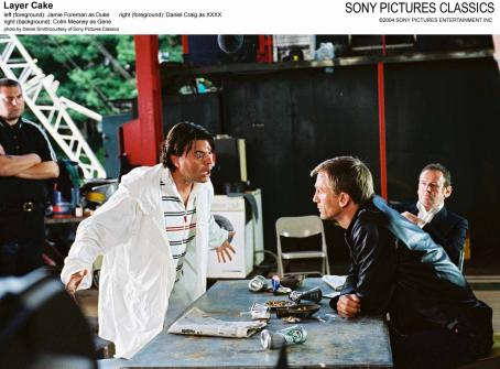 XXXX Left (Foreground): Jamie Foreman as Duke; Right (Foreground): Daniel Craig as ; Right (Background): Colm Meaney as Gene.
