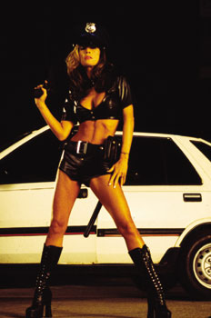 Tabitha Stevens  as the Sexy Police Officer in 'The L.A. Riot Spectacular.' Directed by Marc Klasfeld  -  Copyright ©2005 - 2006